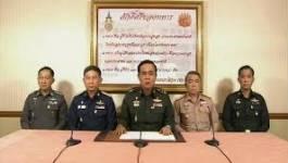 Coup d'État en Thaïlande : le gouvernement déchu se rend à sa convocation
