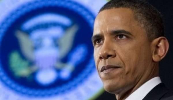 Kadhafi quittera le pouvoir, assure Obama, sans exclure d'armer l'opposition