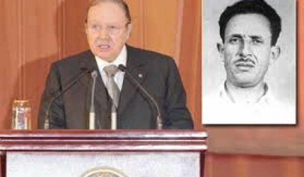 Bouteflika posant devant le portrait d'un illustre chef de l'ALN.