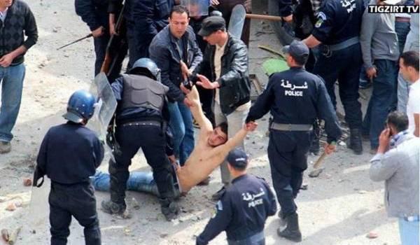 Cette image de policiers, un certain 20 avril à Tizi Ouzou, lynchant un homme à terre restera gravée dans les mémoires