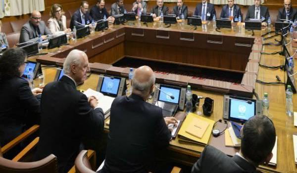 Les négociateurs à Genève. Photo AFP