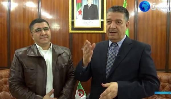 """Le ministre de la Santé, Abdelmalek Boudiaf avec l'obscure chercheur de """"Rahmat Rebbi""""."""